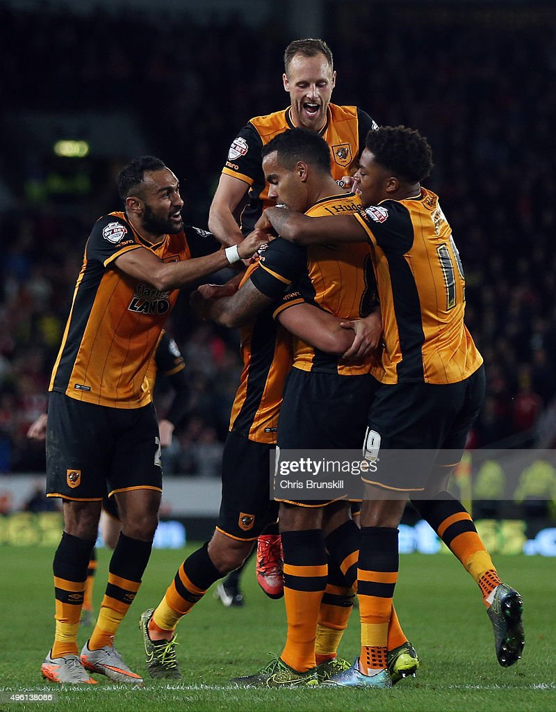 Tom Huddlestone of Hull City is congratulated by his team-mates after scoring his side's third goal during the Sky Bet Championship match between Hull City and Middlesbrough at the KC Stadium on November 7, 2015 in Hull, England.