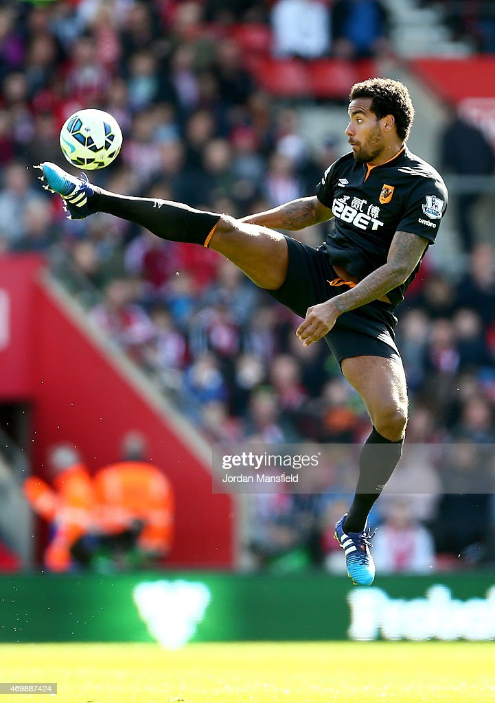 Tom Huddlestone of Hull City jumps to control the ball during the Premier League match between Southampton and Hull City at St Mary's Stadium on April 11, 2015 in Southampton, England.