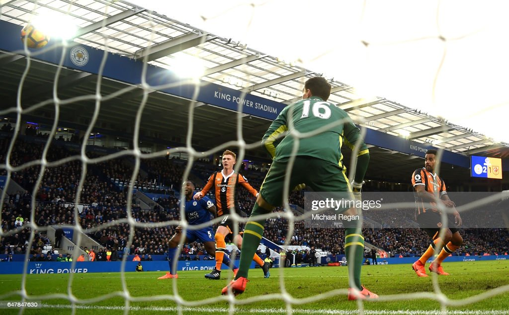 Tom Huddlestone of Hull City (R) scores a goal goal for Leicester City third goal during the Premier League match between Leicester City and Hull City at The King Power Stadium on March 4, 2017 in Leicester, England.