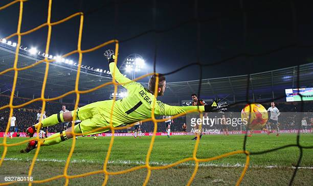 Tom Huddlestone of Hull City scores their first goal from the penalty spot past goakeeper David De Gea of Manchester United during the EFL Cup...