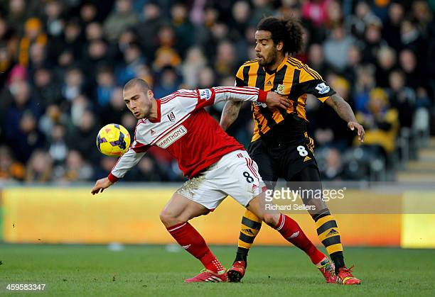 Tom Huddlestone of Hull City tackles Pajtim Kasami of Fulham during the Barclays Premier League match between Hull City and Fulham at KC stadium on...