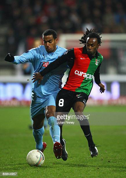 Tom Huddlestone of Spurs battles with Lorenzo Davids of NEC during the UEFA Cup match between NEC Nijmegen and Tottenham Hotspur at the McDOS...