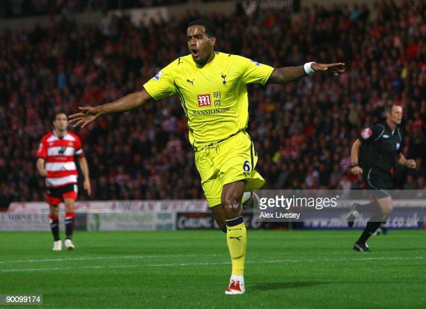 Tom Huddlestone of Tottenham Hotspur celebrates after scoring the opening goal during the Carling Cup second round match between Doncaster Rovers and...
