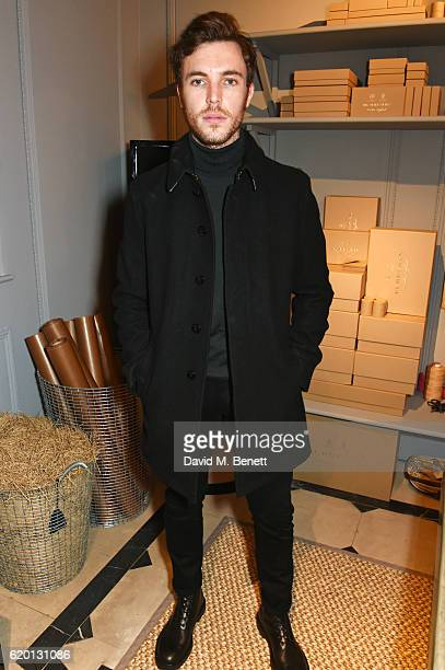 Tom Hughes wearing Burberry attends an event to celebrate 'The Tale of Thomas Burberry' at Burberry's all day cafe Thomas's on November 1 2016 in...