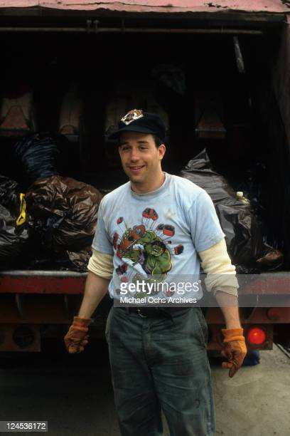 Tom Hulce in front of garbage truck in a scene from the film 'Dominick And Eugene' 1988