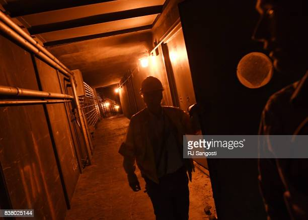Tom Hurst left of Colorado Department of Transportation leads a tour inside the working of the Eisenhower Tunnel on August 23 2017 in Colorado