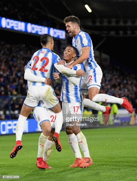 Tom Ince Christopher Schindler Rajiv van La Parra and Tommy Smith of Huddersfield Town celebrate after Nicolas Otamendi of Manchester City scored the...