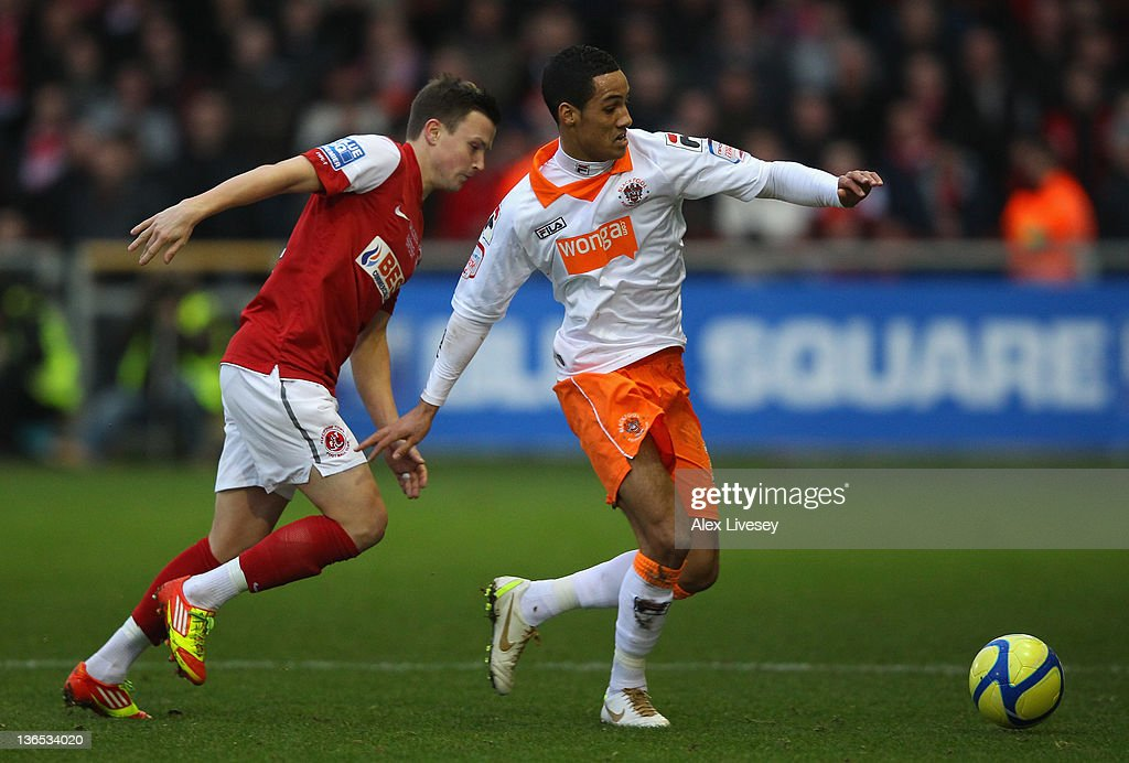Tom Ince of Blackpool beats Andrew Mangan of Fleetwood Town during the FA Cup sponsored by Budweiser third round match between Fleetwood Town and Blackpool at Highbury Stadium on January 7, 2012 in Fleetwood, England.