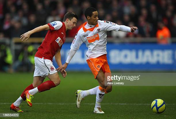 Tom Ince of Blackpool beats Andrew Mangan of Fleetwood Town during the FA Cup sponsored by Budweiser third round match between Fleetwood Town and...