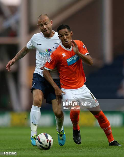 Tom Ince of Blackpool in action with Keith Keane of Preston North End during the Capital One Cup first round match between Preston North End and...