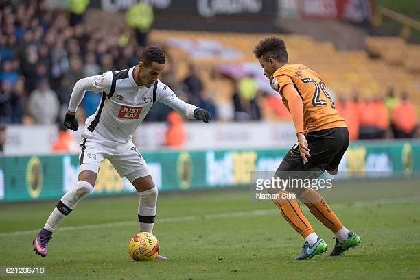 Tom Ince of Derby County and Cameron BorthwickJackson of Wolverhampton Wanderers in action during the Sky Bet Championship match between...