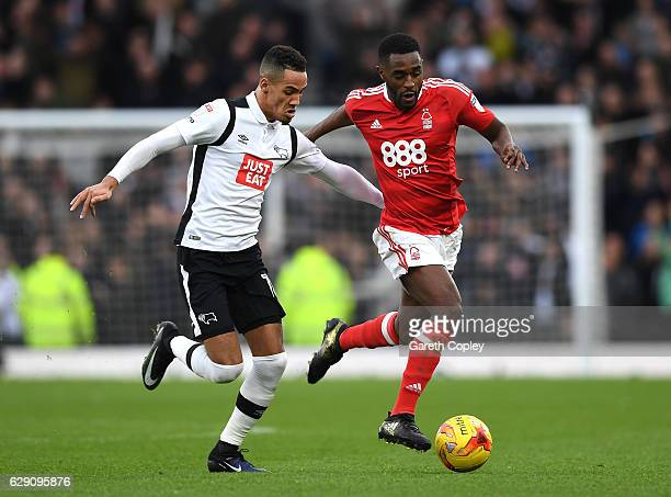 Tom Ince of Derby County and Mustapha Carayol of Nottingham Forest battle for the ball during the Sky Bet Championship match between Derby County and...