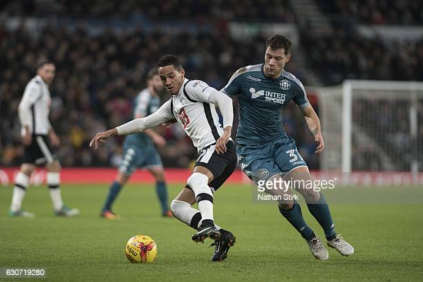 Tom Ince of Derby County and Yanic Wildschut of Wigan Athletic in action during the Sky Bet Championship match between Derby County and Wigan...
