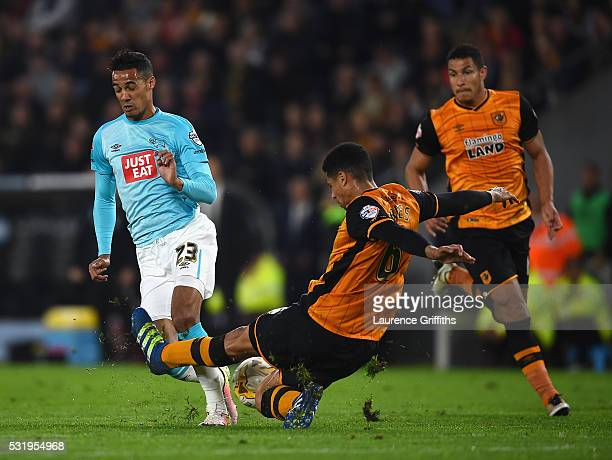 Tom Ince of Derby County battles with Curtis Davies of Hull City during the Sky Bet Championship Play Off semi final second leg match between Hull...