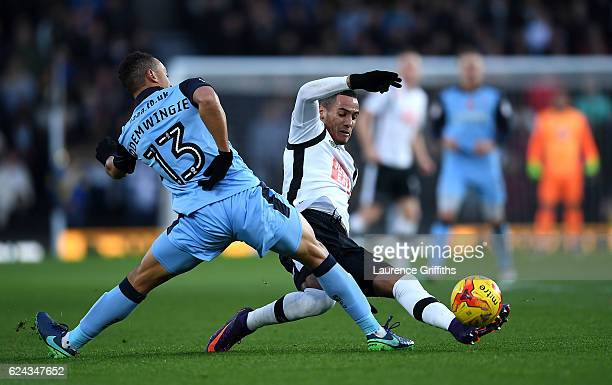 Tom Ince of Derby County battles with Peter Odemwingie of Rotherham United during the Sky Bet Championship match between Derby County and Rotherham...