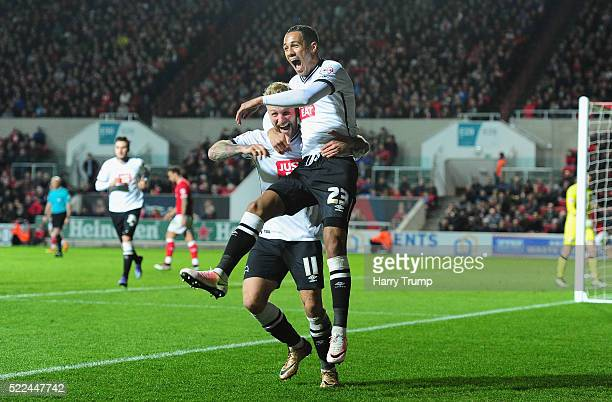 Tom Ince of Derby County celebrates with Johnny Russell of Derby County after scoring his sides third goal during the Sky Bet Championship match...