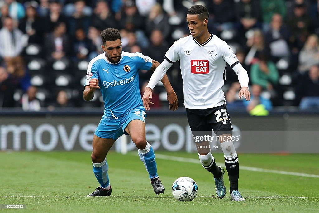 Tom Ince of Derby County FC controls the ball over Scott Golbourne of Wolverhampton Wanderers FC during the Sky Bet Championship match between Derby County and Wolverhampton Wanderers at Pride Park Stadium on October 18, 2015 in Derby, England.