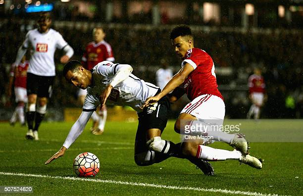Tom Ince of Derby County is tackled by Cameron BorthwickJackson of Manchester United during the Emirates FA Cup fourth round match between Derby...
