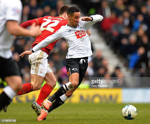 Tom Ince of Derby County is tackled by Gary Gardner of Nottingham Forest during the Sky Bet Championship match between Derby County and Nottingham...