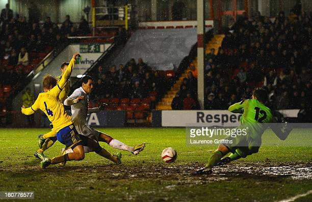 Tom Ince of England battles has his shot saved by Andreas Linde of Sweden during the U21 International match between England U21 and Sweden U21 at...