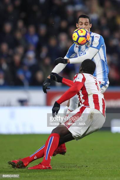 Tom Ince of Huddersfield Town and Kurt Zouma of Stoke City during the Premier League match between Huddersfield Town and Stoke City at John Smith's...