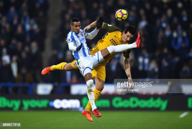Tom Ince of Huddersfield Town and Lewis Dunk of Brighton and Hove Albion compete to win a header during the Premier League match between Huddersfield...