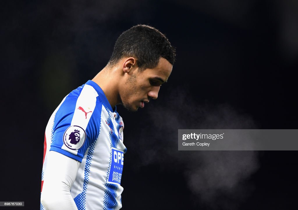 Tom Ince of Huddersfield Town breathes out showing the cold during the Premier League match between Huddersfield Town and Stoke City at John Smith's Stadium on December 26, 2017 in Huddersfield, England.