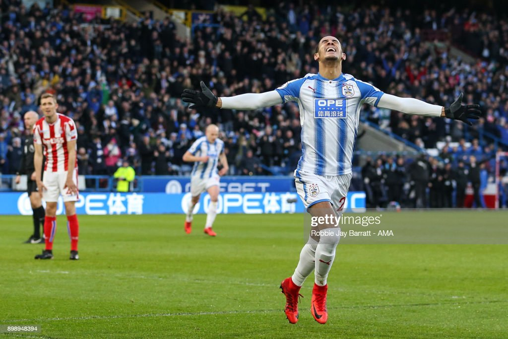 Tom Ince of Huddersfield Town celebrates after scoring a goal to make it 1-0 during the Premier League match between Huddersfield Town and Stoke City at John Smith's Stadium on December 26, 2017 in Huddersfield, England.