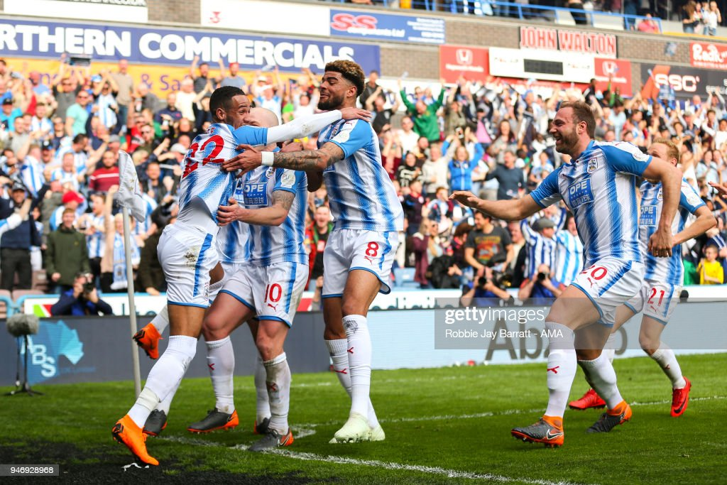 Tom Ince of Huddersfield Town celebrates after scoring a goal to make it 1-0 during the Premier League match between Huddersfield Town and Watford at John Smith's Stadium on April 14, 2018 in Huddersfield, England.