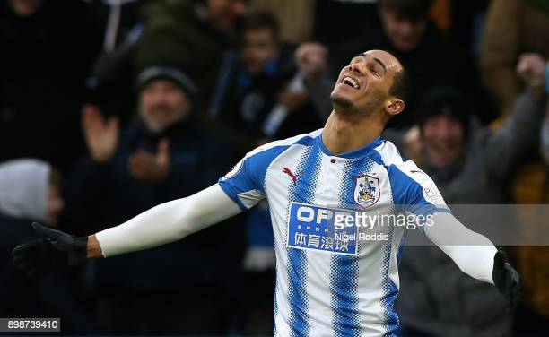 Tom Ince of Huddersfield Town celebrates after scoring his sides first goal during the Premier League match between Huddersfield Town and Stoke City...