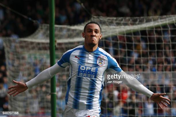 Tom Ince of Huddersfield Town celebrates after scoring his sides first goal during the Premier League match between Huddersfield Town and Watford at...