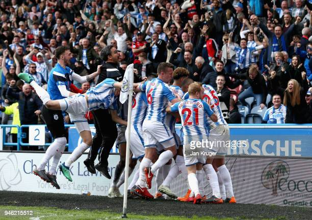 Tom Ince of Huddersfield Town celebrates with teammates and his manager David Wagner after scoring his sides first goal during the Premier League...