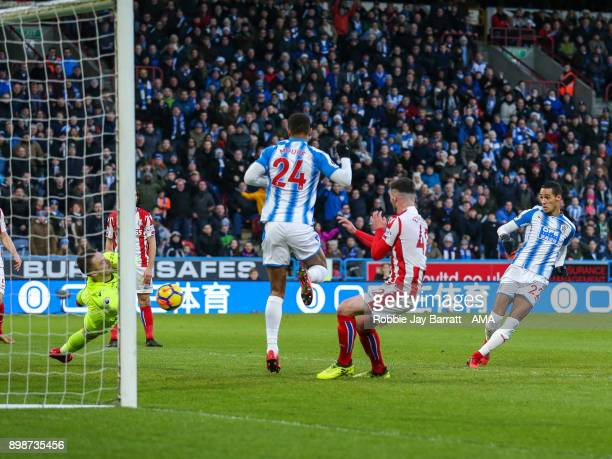 Tom Ince of Huddersfield Town scores a goal to make it 10 during the Premier League match between Huddersfield Town and Stoke City at John Smith's...