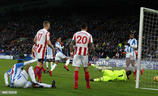 Tom Ince of Huddersfield Town scores his sides first goal during the Premier League match between Huddersfield Town and Stoke City at John Smith's...