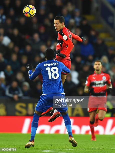 Tom Ince of Huddersfield Town wins a header from Daniel Amartey of Leicester City during the Premier League match between Leicester City and...