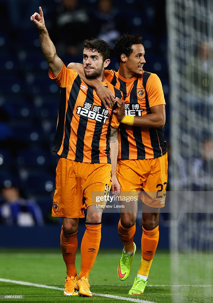 Tom Ince of Hull City congratulates Robbie Brady on his goal during the Capital One Cup Third Round match between West Bromwich Albion and Hull City at The Hawthorns on September 24, 2014 in West Bromwich, England.
