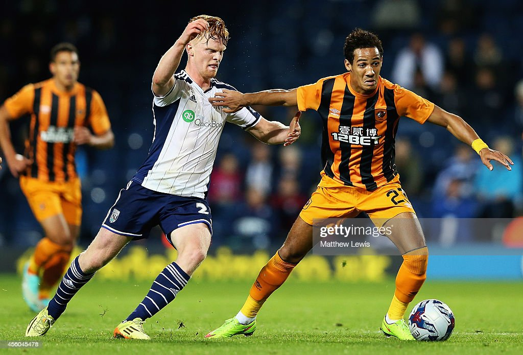 Tom Ince of Hull City holds off Liam O'Neil of West Bromwich Albion during the Capital One Cup Third Round match between West Bromwich Albion and Hull City at The Hawthorns on September 24, 2014 in West Bromwich, England.