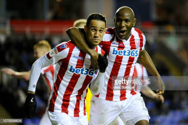 Tom Ince of Stoke City celebrates with teammate Benik Afobe after scoring his team's second goal during the Sky Bet Championship match between...