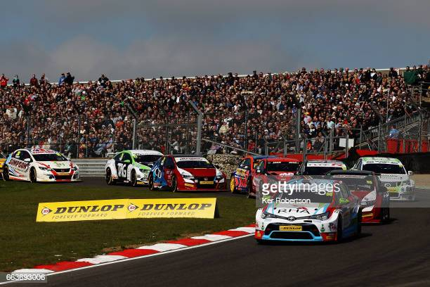 Tom Ingram of Speedworks Motorsport Toyota leads the field into Paddock Hill Bend on lap one on his way to winning round one of the Dunlop MSA...
