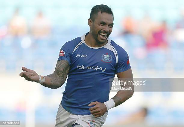 Tom Iosefo of Samoa celebrates scoring a try during the 2014 Gold Coast Sevens Cup semi-final match between South Africa and Samoa at Cbus Super...