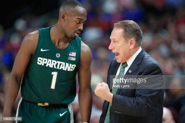 Tom Izzo the head coach talks with Joshua Langford of the Michigan State Spartans shoots the ball against the Kansas Jayhawks during the State Farm...