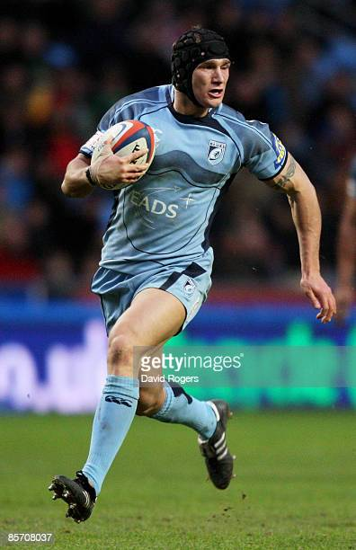 Tom James of Cardiff runs with the ball during the EDF Energy Cup Semi Final between Cardiff Blues and Northampton Saints at the Ricoh Arena on March...