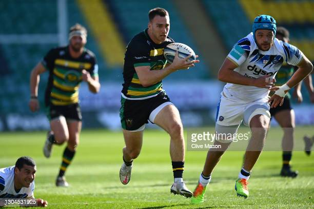Tom James of Northampton Saints breaks through and goes on to score a try during the Gallagher Premiership Rugby match between Northampton Saints and...
