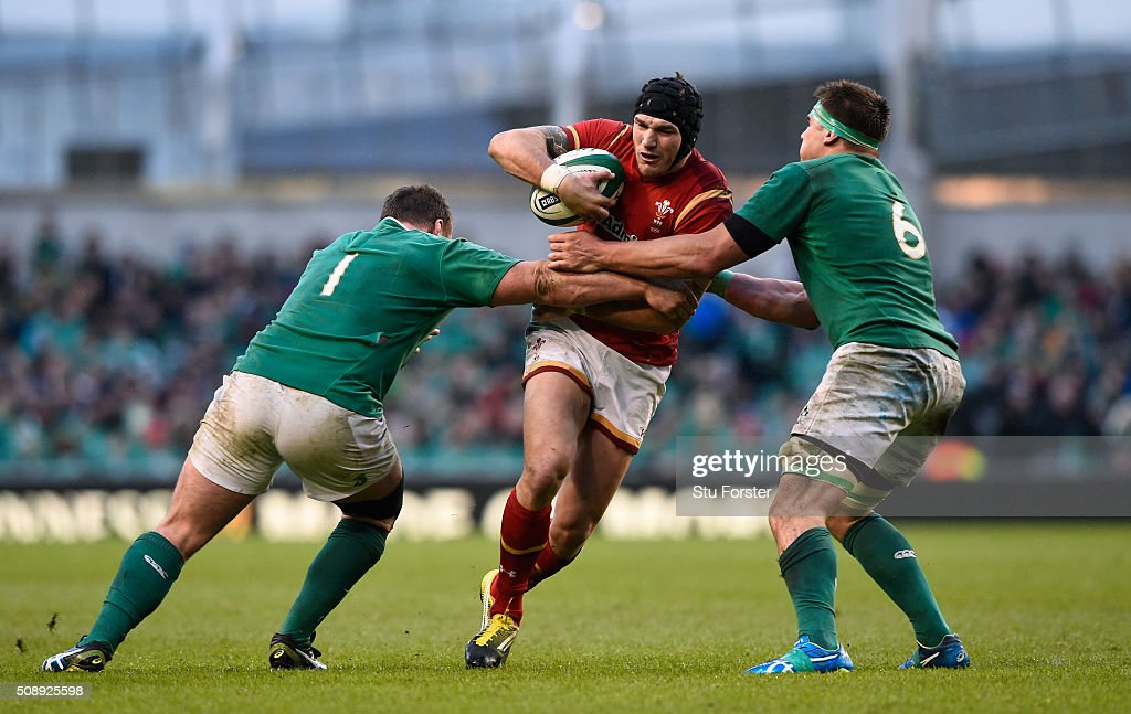 Tom James of Wales is tackled by Jack McGrath and CJ Stander of Ireland during the RBS Six Nations match between Ireland and Wales at the Aviva Stadium on February 7, 2016 in Dublin, Ireland.