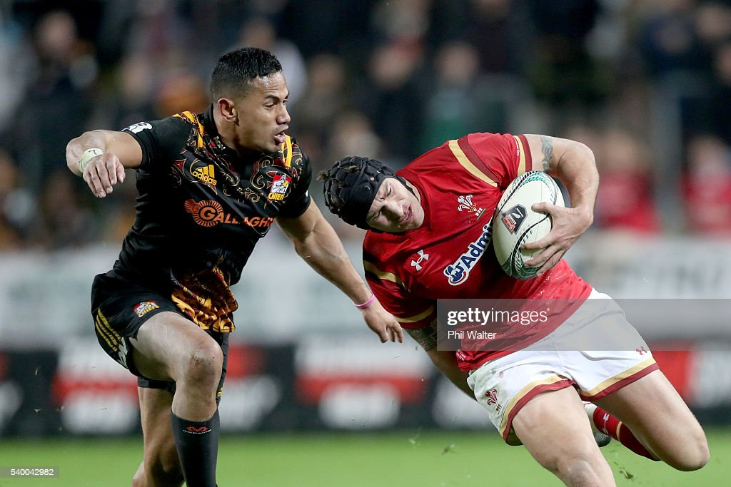 Tom James of Wales is tackled by Toni Pulu of the Chiefs during the International Test match between the Chiefs and Wales at Waikato Stadium on June 14, 2016 in Hamilton, New Zealand.