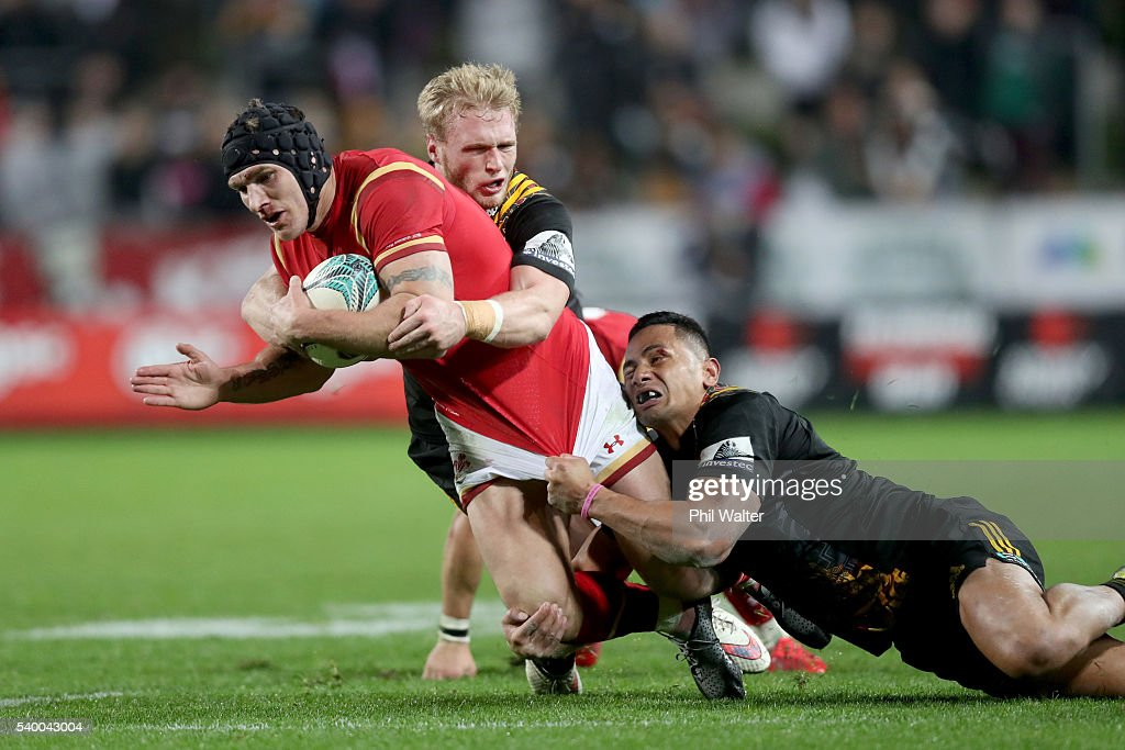 Tom James of Wales is tackled during the International Test match between the Chiefs and Wales at Waikato Stadium on June 14, 2016 in Hamilton, New Zealand.