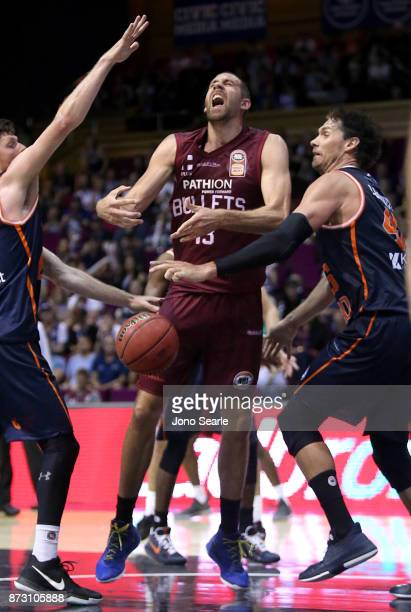 Tom Jervis of Brisbane is fouled during the round six NBL match between the Brisbane Bullets and the Cairns Taipans at Brisbane Convention Exhibition...