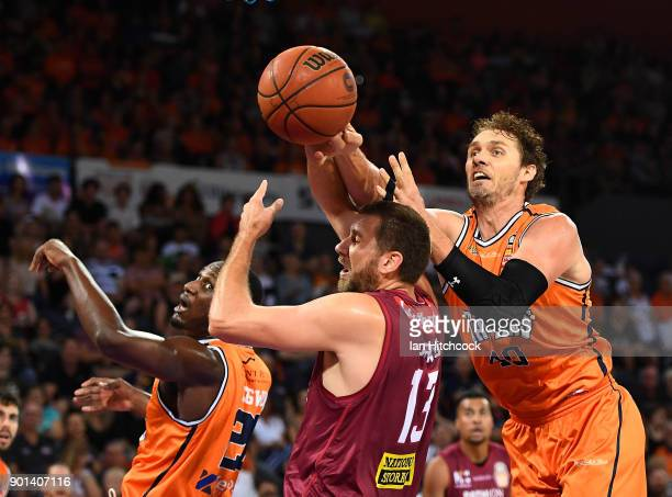 Tom Jervis of the Bullets contests the ball with Alex Loughton of the Taipans during the round 13 NBL match between the Cairns Taipans and the...