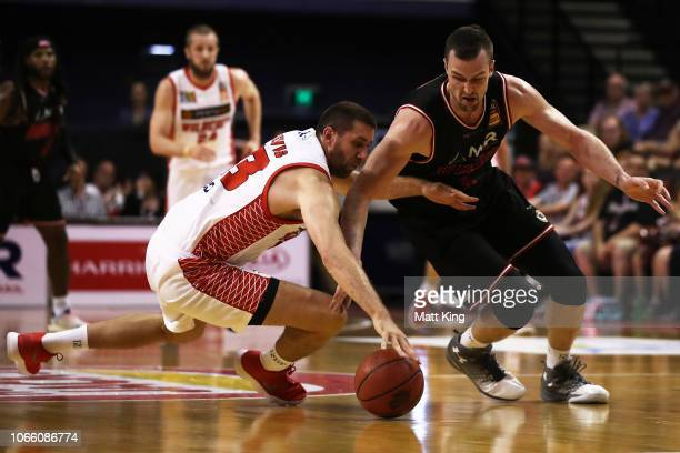 Tom Jervis of the Wildcats competes for the ball against AJ Ogilvy of the Hawks during the round five NBL match between the Illawarra Hawks and the...