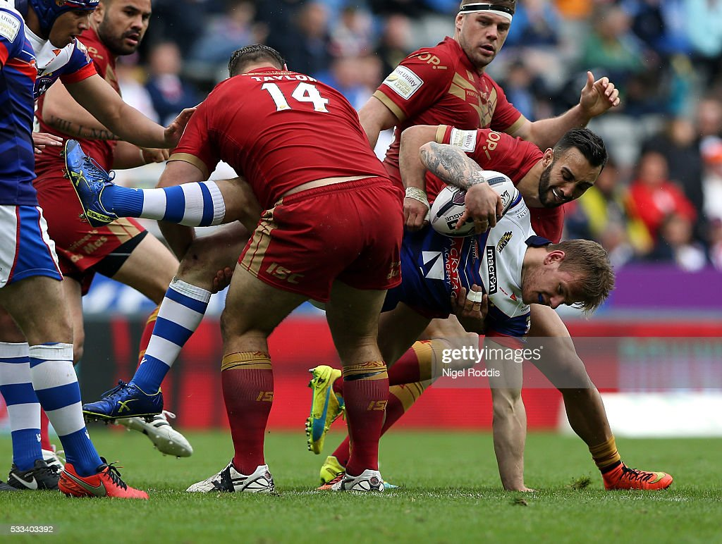Tom Johnstone of Wakefield Wildcats (2ndR) tackled by Dave Taylor (L) and Eloi Pelissier (R) of Catalans Dragons during the First Utility Super League match between Wakefield Wildcats and Catalans Dragons at St James' Park on May 22, 2016 in Newcastle upon Tyne, England.